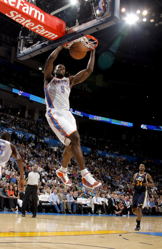 Photo - Oklahoma City's Serge Ibaka (9) dunks during the NBA basketball game between the Oklahoma City Thunder and Utah Jazz, Wednesday, March 23, 2011, at the Oklahoma City Arena. Photo by Sarah Phipps, The Oklahoman