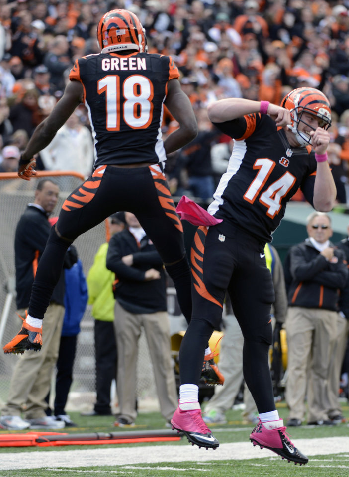 Cincinnati Bengals wide receiver A.J. Green (18) and quarterback Andy Dalton (14) celebrate after they connected on a 2-yard touchdown pass in the second half of an NFL football game against the Miami Dolphins, Sunday, Oct. 7, 2012, in Cincinnati. (AP Photo/Michael Keating)