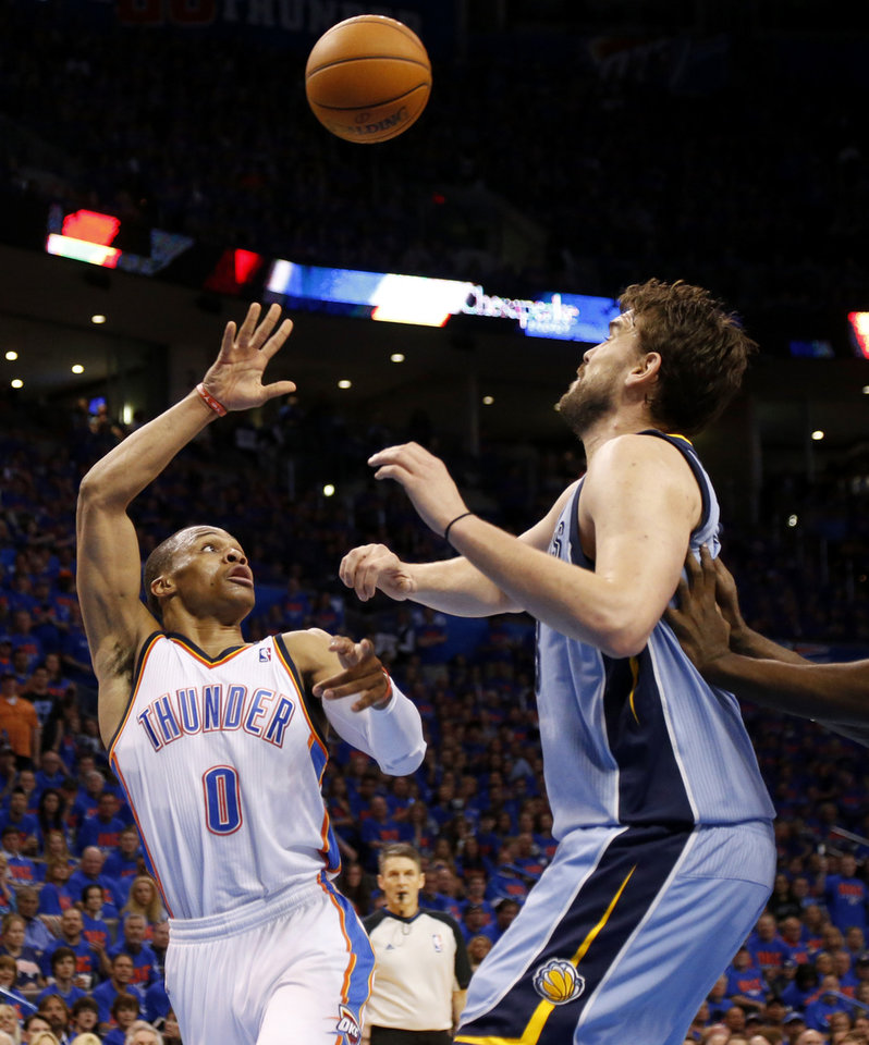 Photo - Oklahoma City's Russell Westbrook (0) passes over Memphis' Marc Gasol (33) during Game 7 in the first round of the NBA playoffs between the Oklahoma City Thunder and the Memphis Grizzlies at Chesapeake Energy Arena in Oklahoma City, Saturday, May 3, 2014. Photo by Nate Billings, The Oklahoman