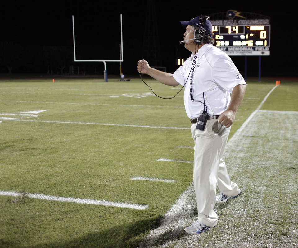 Photo - HH coach Andy Bogert shouts to his team during the high school football game between Heritage Hall and NOAH in Oklahoma City, Friday, Oct. 1, 2010. Photo by Doug Hoke, The Oklahoman.