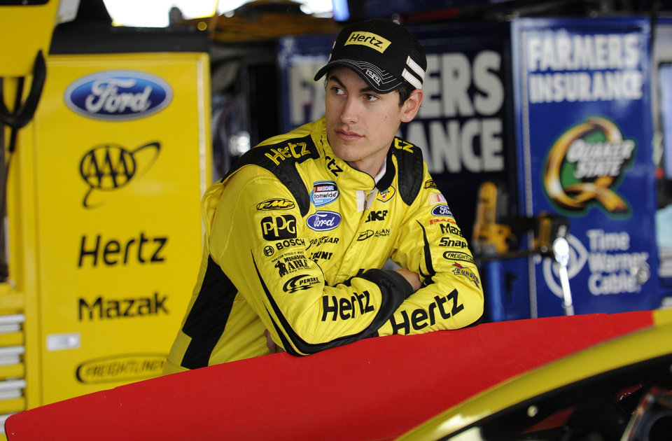 Photo - Joey Logano looks on before practice for Sunday's NASCAR Sprint Cup series auto race, Saturday, Sept. 28, 2013, at Dover International Speedway in Dover, Del. (AP Photo/Nick Wass)