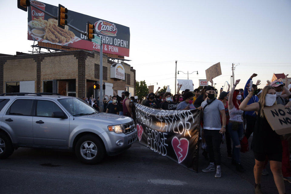 Photo - Protesters gather Saturday, May 30, 2020, near NW 23rd and Classen in Oklahoma City. Photo by Bryan Terry