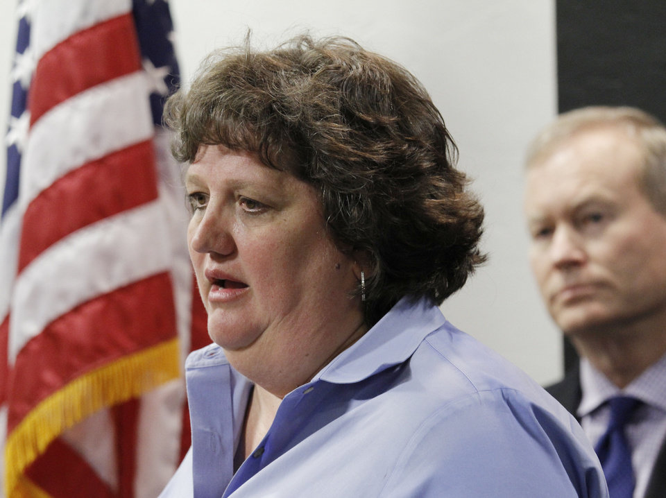Photo - Kari Watkins, Oklahoma City National Memorial and Museum executive director, speaks Monday at a news conference about concerns for the upcoming Memorial Marathon after the bombings in Boston. Photo by Doug Hoke, The Oklahoman