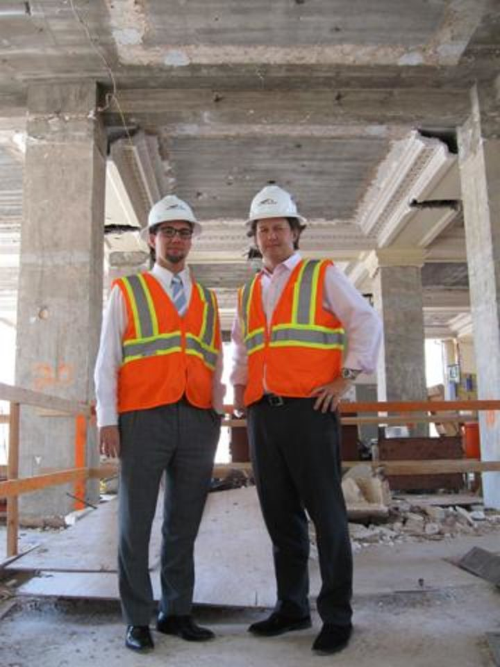 Greg Dewey, SandRidge vice president of communications, and Keith Paul, owner of Good Egg Dining Group, inspect the site. PHOTO BY STEVE LACKMEYER, THE OKLAHOMAN