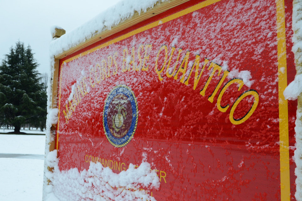 ADDS FIRST NAME AND RANK OF BASE SPOKESMAN - This image provided by the U.S. Marine Corps shows snow covering one of Marine Corps Base Quantico�s many signs Wednesday March 6, 2013. Three people, including the suspect, were killed in a shooting at Marine Base Quantico, a base spokesman said early Friday March 22, 2013. Lt. Agustin Solivan said they believe the suspect, whose name wasn't released, is a staff member at the officer candidate school at the base. No information on the victim was immediately released. (AP Photo/US Marine Corps, Cpl. Antwaun L. Jefferson)