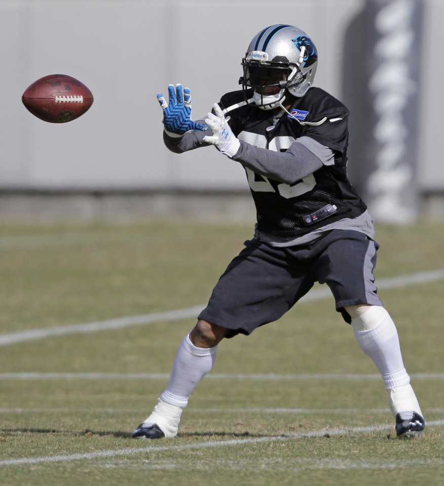 Photo - Carolina Panthers receiver Steve Smith reaches for a catch during an NFL football practice in Charlotte, N.C., Thursday, Jan. 9, 2014. Smith and running back Jonathan Stewart are returning from injuries. The Panthers face the San Francisco 49ers in an NFC Divisional playoff game on Sunday. (AP Photo/Chuck Burton)
