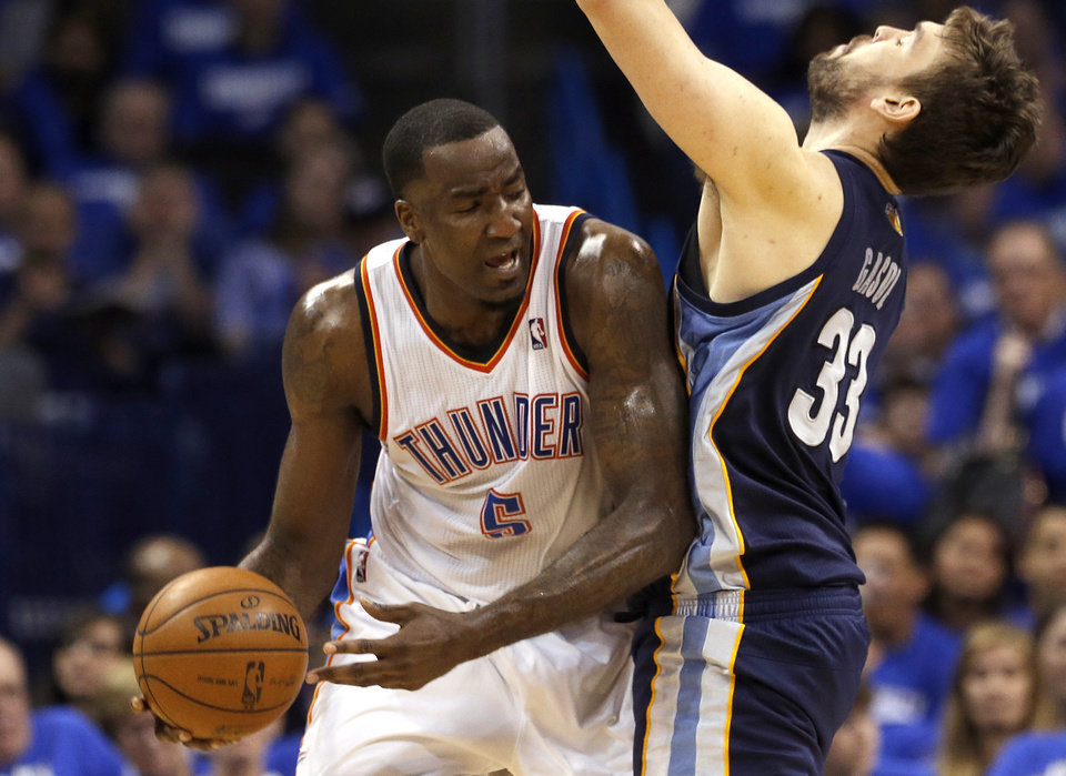 Photo - Oklahoma City's Kendrick Perkins (5) tries to get by Memphis' Marc Gasol (33) during Game 1 in the second round of the NBA playoffs between the Oklahoma City Thunder and the Memphis Grizzlies at Chesapeake Energy Arena in Oklahoma City, Sunday, May 5, 2013. Photo by Sarah Phipps, The Oklahoman