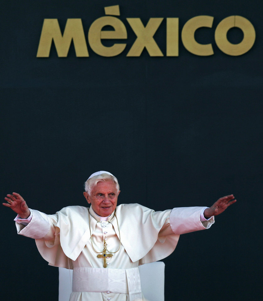 In this March 26, 2012 photo, Pope Benedict XVI waves to the crowd during his departure ceremony at the airport in Silao, Mexico. On Monday, Feb. 11, the Vatican announced that Pope Benedict XVI will resign on Feb. 28. <strong>Alexandre Meneghini - AP</strong>