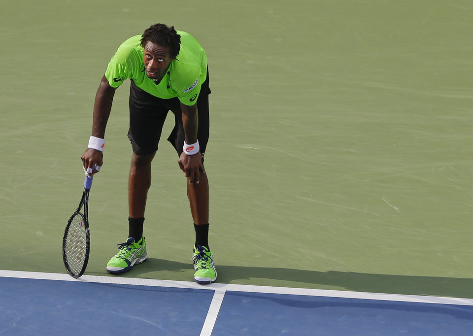 Photo - Gael Monfils, of France, watches a replay of a point during the fourth round against Grigor Dimitrov, of Bulgaria, at the 2014 U.S. Open tennis tournament, Tuesday, Sept. 2, 2014, in New York. (AP Photo/Darron Cummings)