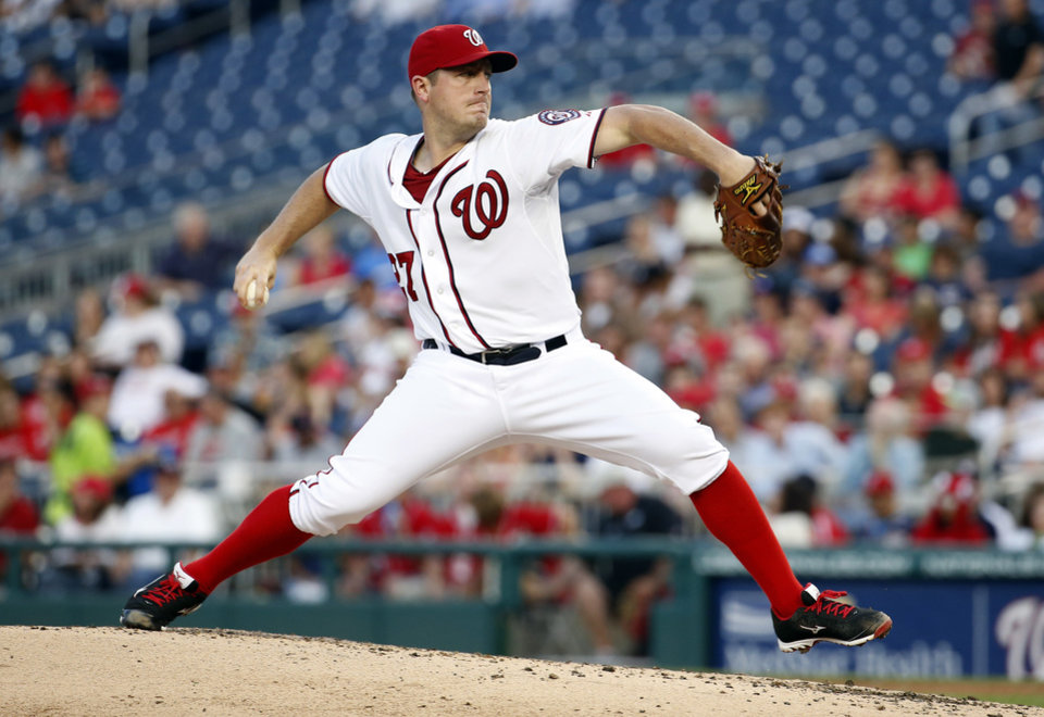Photo - Washington Nationals starting pitcher Jordan Zimmermann (27) throws during the fourth inning of a baseball game against the Philadelphia Phillies at Nationals Park Tuesday, June 3, 2014, in Washington. (AP Photo/Alex Brandon)