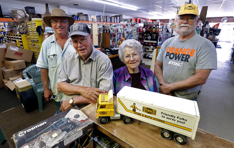 Photo - E.J. and Nancy Crow pose with their sons in their OTASCO store on Tuesday, July 8, 2014 in Marlow, Okla.  Today their son Mike, right, runs the operation and retired son Ron, left, helps out.  Photo by Steve Sisney, The Oklahoman