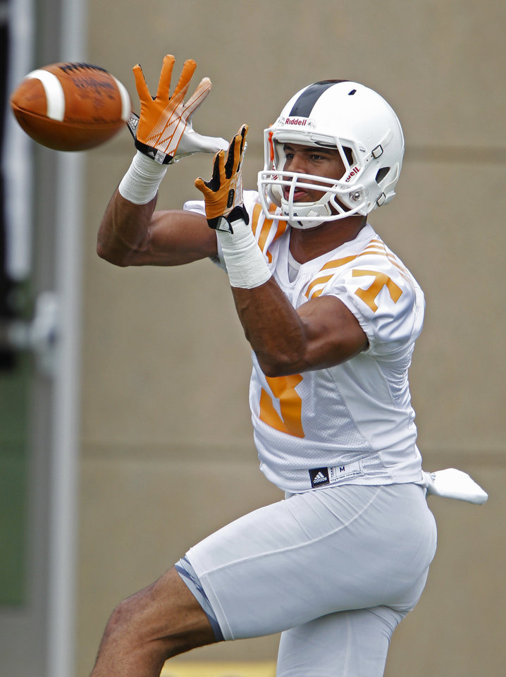 Photo - Tennessee wide receiver Josh Malone (3) catches the ball during practice at Haslam Field, Saturday, Aug. 2, 2014 in Knoxville, Tenn.  (AP Photo/The Knoxville News Sentinel, Wade Payne)
