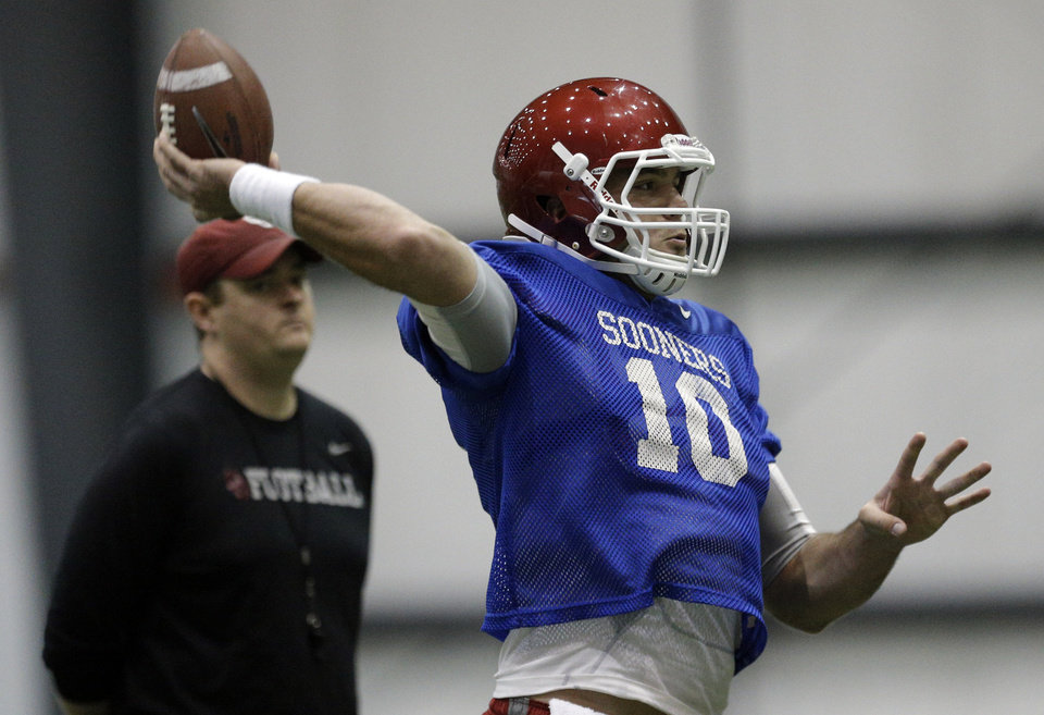 Oklahoma 's Blake Bell (10) throws during a Sugar Bowl practice at the New Orleans Saints' football practice facility, Tuesday, Dec. 31, 2013, in New Orleans. Photo by Sarah Phipps, The Oklahoman