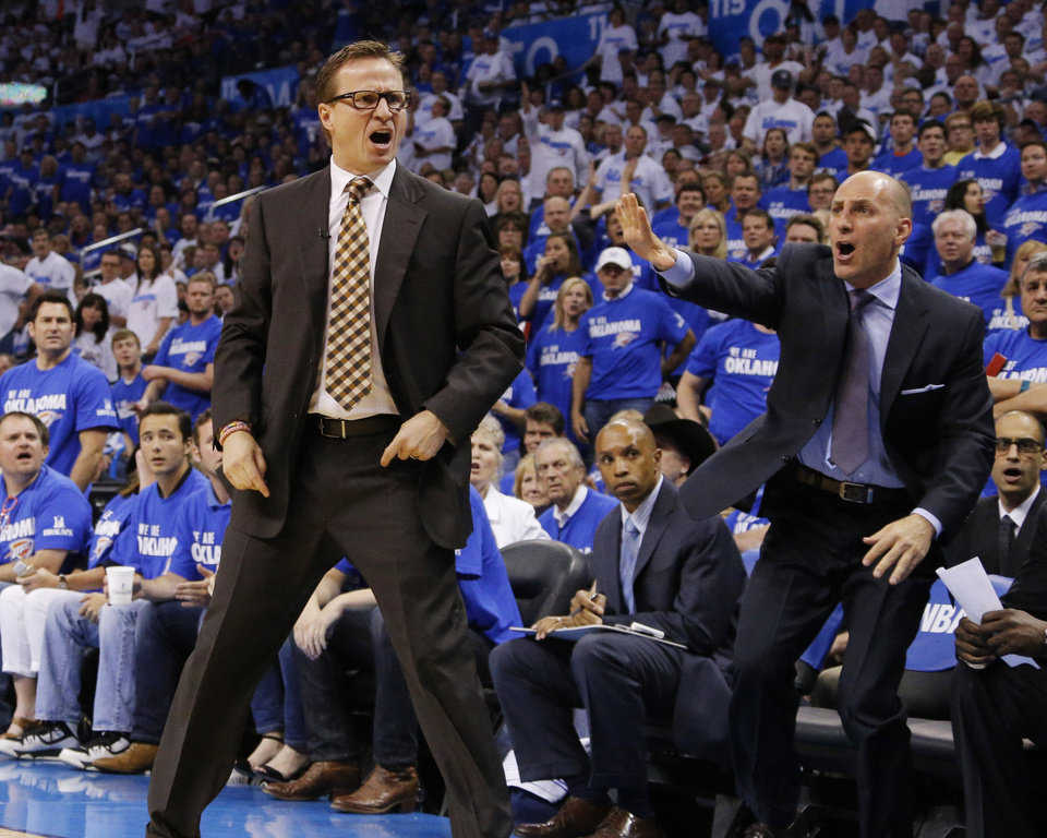 Photo - Thunder head coach Scott Brooks and assistant Rex Kalamian are upset over a call during Game 2 of the Western Conference semifinals in the NBA playoffs between the Oklahoma City Thunder and the Los Angeles Clippers at Chesapeake Energy Arena in Oklahoma City, Wednesday, May 7, 2014. Photo by Bryan Terry, The Oklahoman