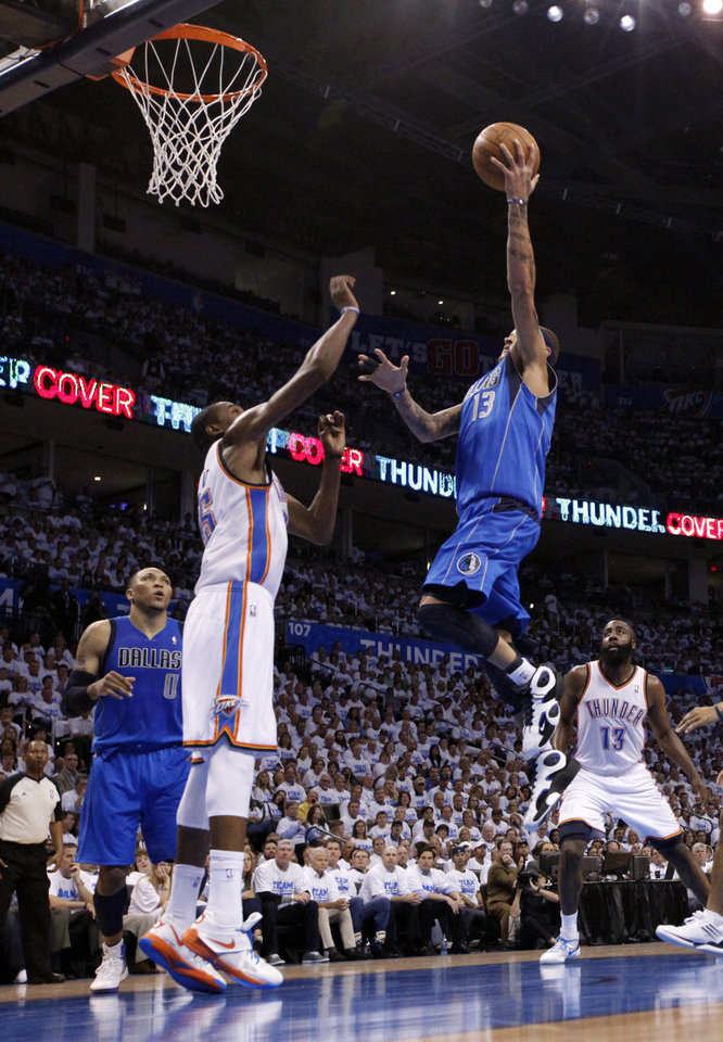 Photo - Dallas' Delonte West (13) shoots over Oklahoma City's Kevin Durant (35) during Game 2 of the first round in the NBA basketball playoffs between the Oklahoma City Thunder and the Dallas Mavericks at Chesapeake Energy Arena in Oklahoma City, Monday, April 30, 2012. Photo by Sarah Phipps, The Oklahoman