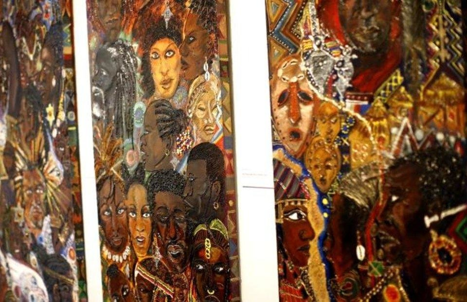Photo - A detail of a trio of large painted panels by Albert Bostick is shown during the opening reception of
