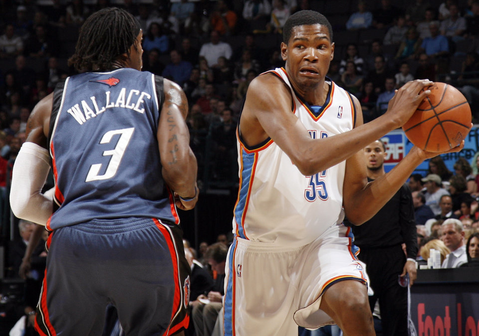 Photo - Oklahoma City's Kevin Durant (35) tries to get the ball past Gerald Wallace (3) of Charlotte in the first half of the NBA basketball game between the Charlotte Bobcats and the Oklahoma City Thunder at the Ford Center in Oklahoma City, Friday, April 10, 2009. Photo by Nate Billings, The Oklahoman ORG XMIT: KOD
