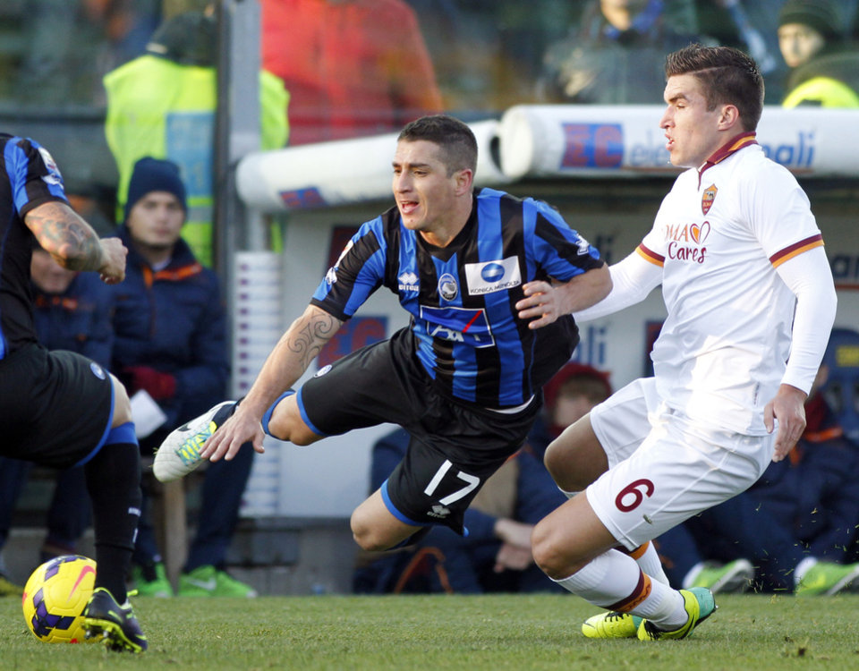Photo - Atalanta's Carlos Carmona, left, of Chile, is fouled by AS Roma's Dutch Kevin Strootman during a Serie A soccer match in Bergamo, Italy, Sunday, Dec. 1, 2013. (AP Photo/Felice Calabro')