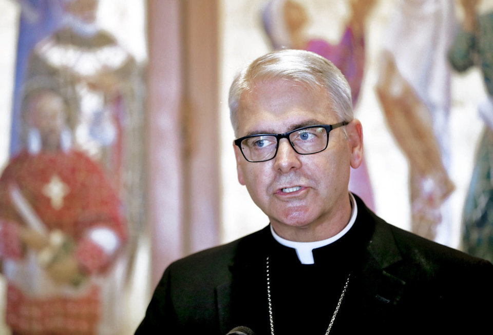 "Left: Oklahoma City Archbishop Paul S. Coakley talks Monday about the resignation of Pope Benedict XVI during a news conference. ""I thought it was a prank,"" he said. ""This news has caught all of us by surprise."" Photo by Chris Landsberger, The Oklahoman"