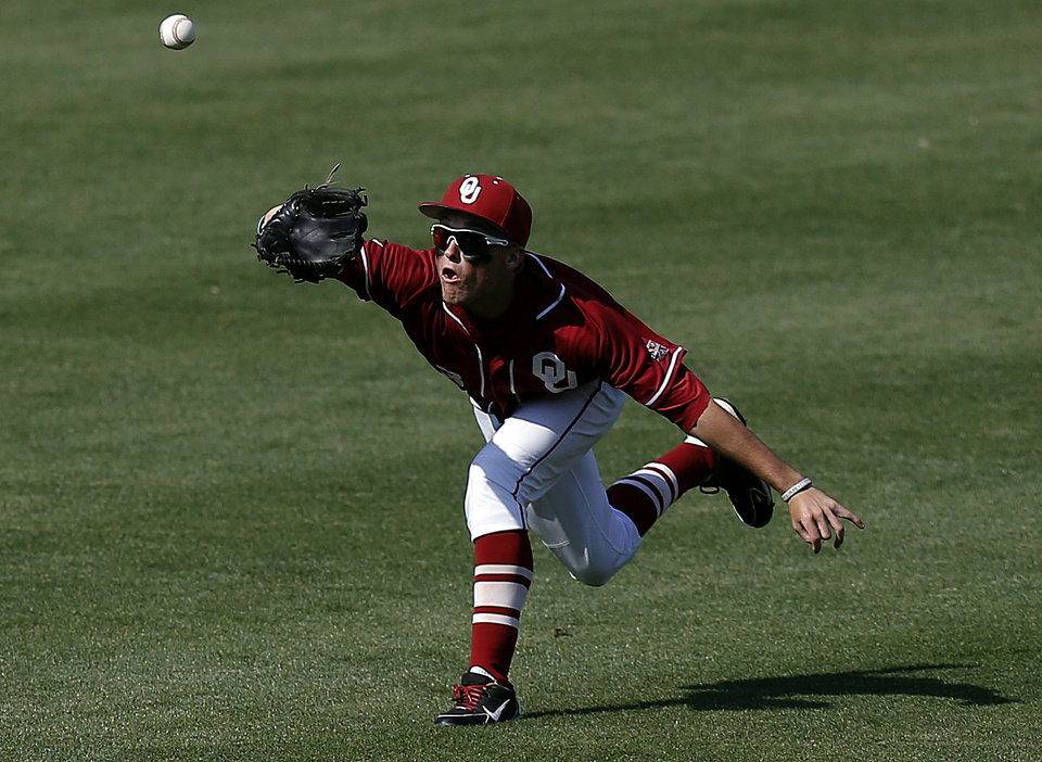 Oklahoma's Craig Aikin makes a catch during the Bedlam baseball game between the University of Oklahoma and Oklahoma State University at the Chickasaw Bricktown Ballpark in Oklahoma CIty, Saturday, May 11, 2013. Photo by Sarah Phipps, The Oklahoman
