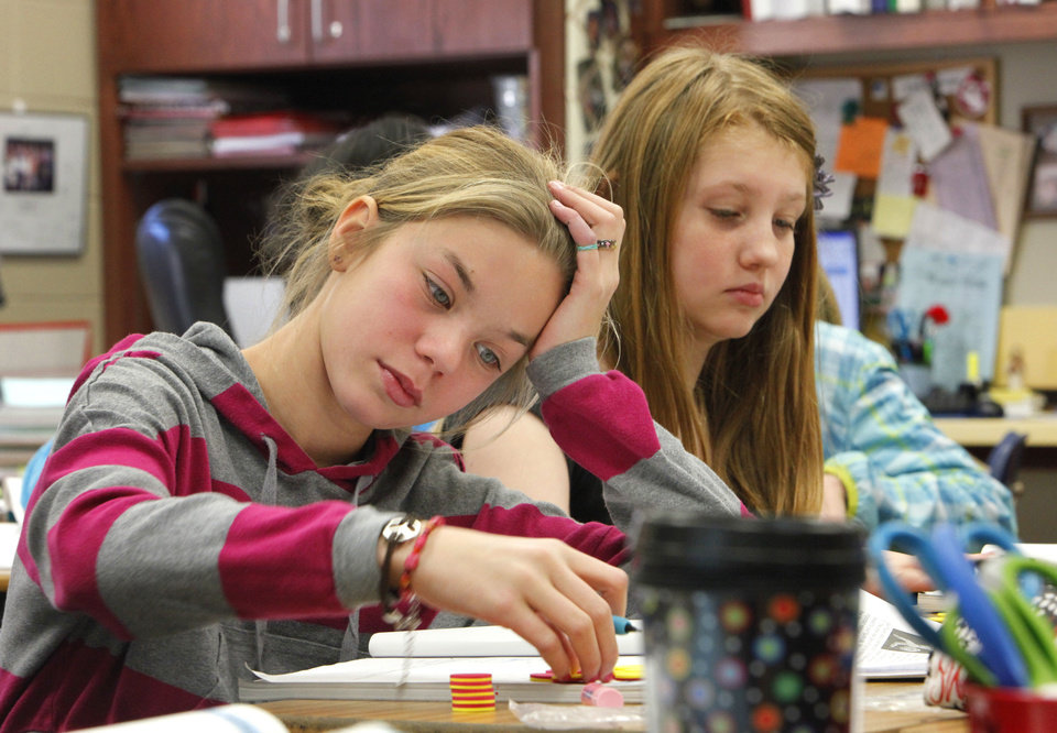 Fifth graders Launi Horany and Amanda Roomsburg work on a math lessen at Centennial Elementary School in Edmond.  Photo By David McDaniel/The Oklahoman <strong>David McDaniel - The Oklahoman</strong>