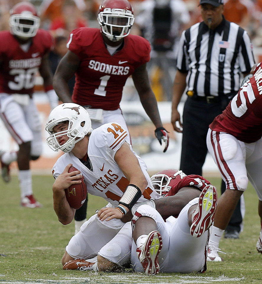 Photo - OU's Casey Walker (53) brings down UT's David Ash (14) during the Red River Rivalry college football game between the University of Oklahoma (OU) and the University of Texas (UT) at the Cotton Bowl in Dallas, Saturday, Oct. 13, 2012. Oklahoma won 63-21. Photo by Bryan Terry, The Oklahoman