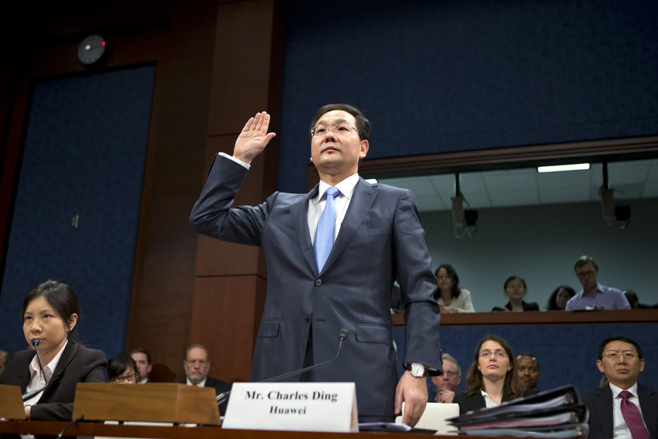 Photo -   Charles Ding, Huawei Technologies Ltd's senior vice president for the U.S., is sworn in on Capitol Hill in Washington, Thursday, Sept. 13, 2012, prior to testifying before the House Intelligence Committee as lawmakers probe whether Chinese tech giants' expansion in the U.S. market pose a threat to national security. (AP Photo/J. Scott Applewhite)