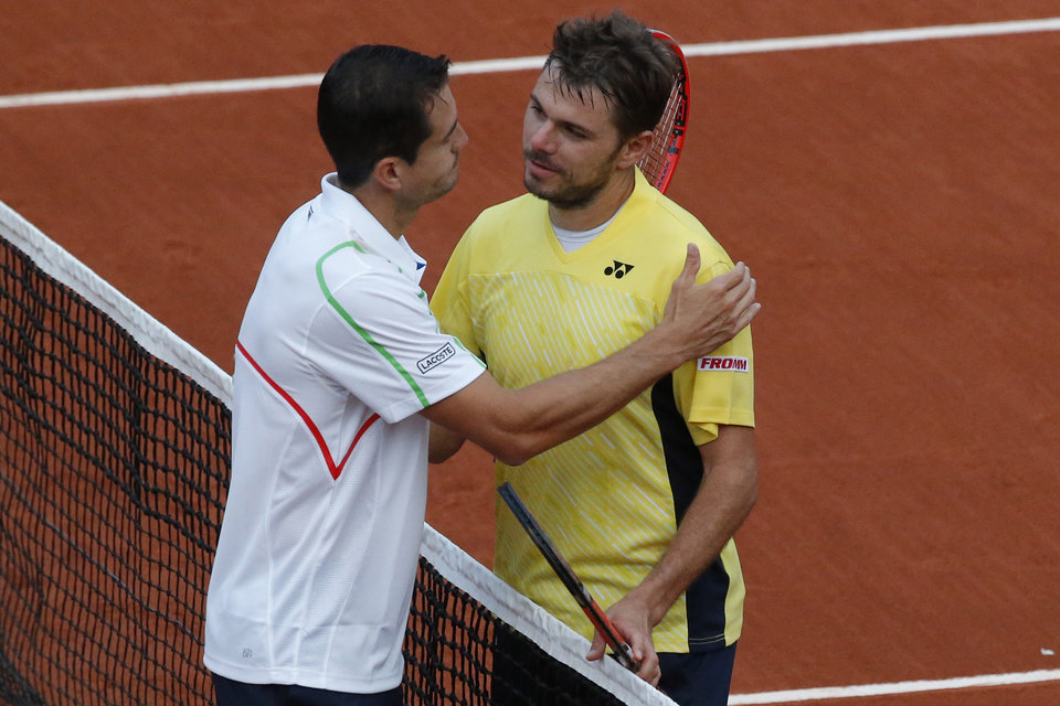 Photo - Switzerland's Stanislas Wawrinka greets Spain's Guillermo Garcia-Lopez, left, after losing the first round match of the French Open tennis tournament in four sets at the Roland Garros stadium, in Paris, France, Monday, May 26, 2014. (AP Photo/Michel Euler)