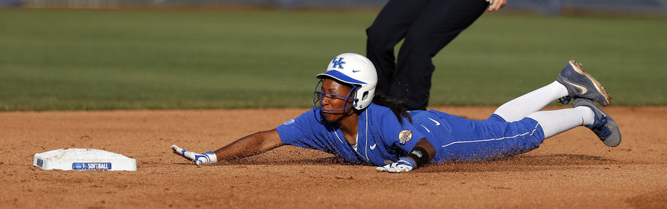 Photo - Kentucky's Krystal Smith slides to second base in the second inning aginst La.-Lafayette in a Women's College World Series game at ASA Hall of Fame Stadium in Oklahoma City Thursday, May 29, 2014. Photo by Bryan Terry, The Oklahoman