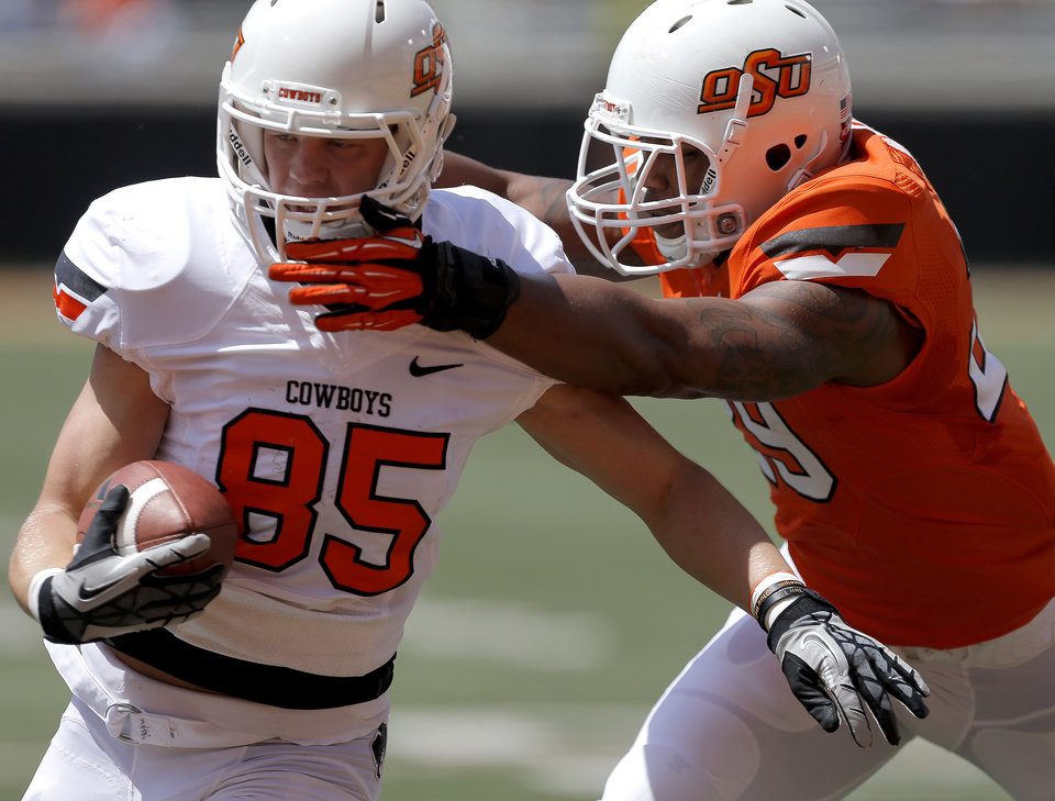 Oklahoma State\'s Blake Webb scores a touchdown past Joe Mitchell during OSU\'s spring football game at Boone Pickens Stadium in Stillwater, Okla., Sat., April 20, 2013. Photo by Bryan Terry, The Oklahoman