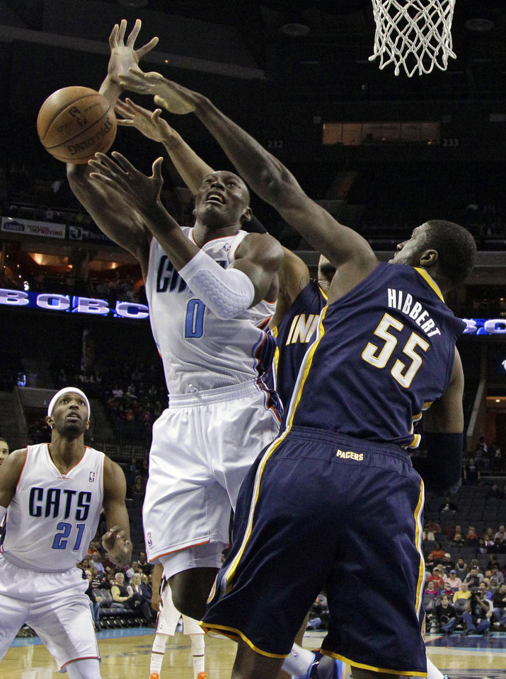 Charlotte Bobcats' Bismack Biyombo (0) has his shot blocked by Indiana Pacers' Roy Hibbert (55) during the first half of an NBA basketball game in Charlotte, N.C., Tuesday, Jan. 15, 2013. (AP Photo/Chuck Burton)