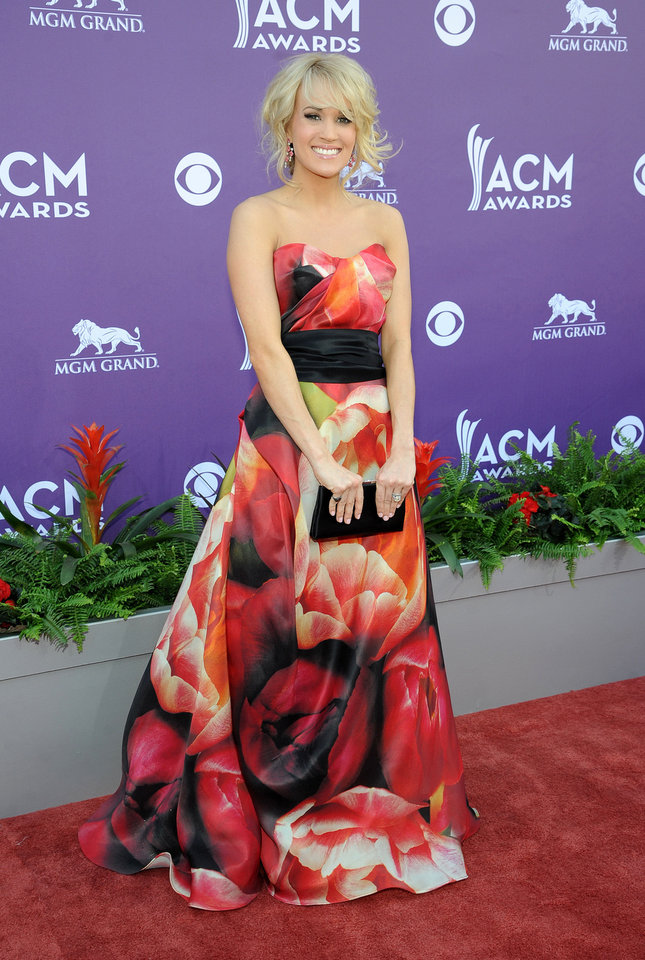 Singer Carrie Underwood arrives at the 48th Annual Academy of Country Music Awards at the MGM Grand Garden Arena in Las Vegas on Sunday, April 7, 2013. (Photo by Al Powers/Invision/AP) ORG XMIT: NVPM163 Al Powers - Al Powers/Invision/AP