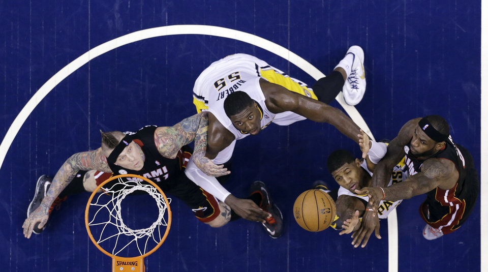 Photo - Miami Heat's LeBron James, right, puts up a shot over Indiana Pacers defenders Paul George, Roy Hibbert (55) as Heat's Chris Andersen, left, watches during the first half of Game 3 of the NBA Eastern Conference basketball finals in Indianapolis, Sunday, May 26, 2013. (AP Photo/Michael Conroy)