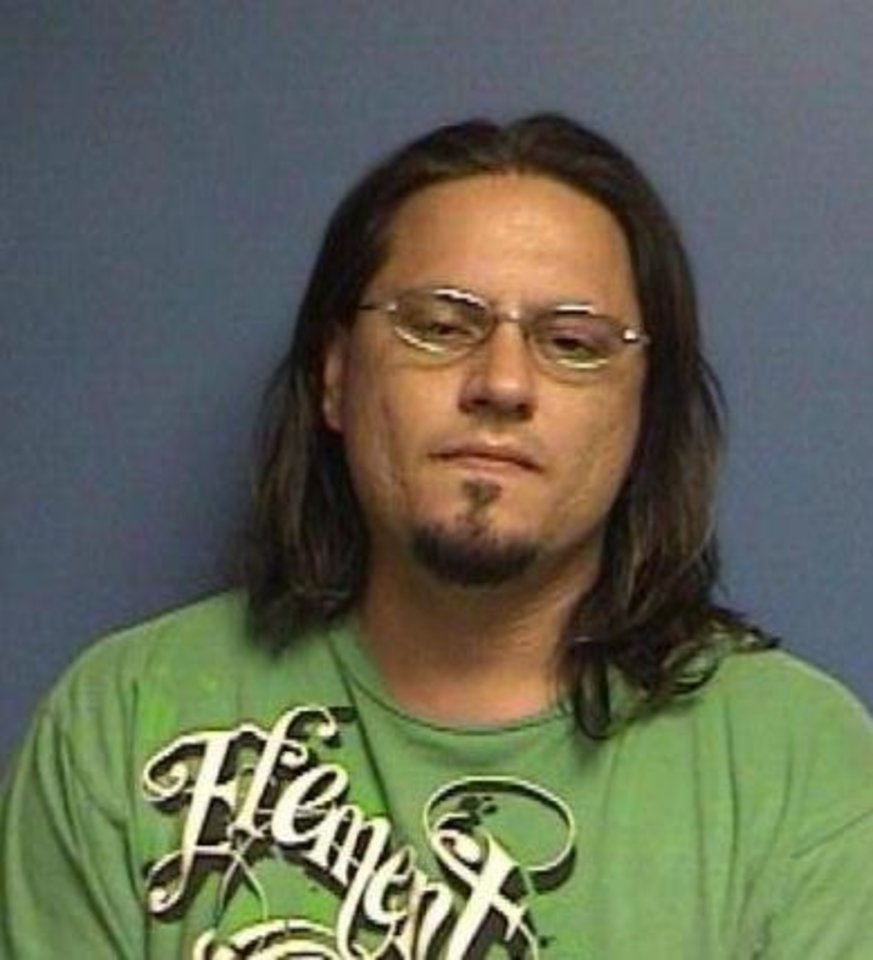 Photo - JOHN MORRIS / ARREST: John Paul Morris, 32, of Binger was arrested Tuesday during a drug raid in Caddo County.     ORG XMIT: 0907152225377155