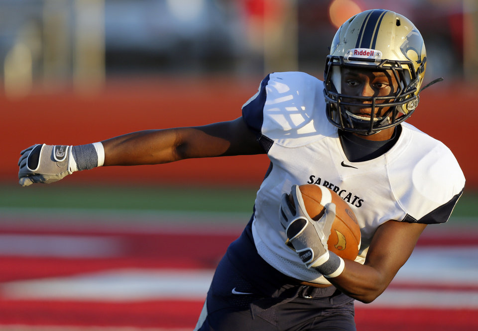 Southmoore\'s Jaelon Walker (3) looks for running room during a high school football game between Carl Albert and Southmoore in Midwest City, Okla., Friday, Aug. 31, 2012. Photo by Nate Billings, The Oklahoman