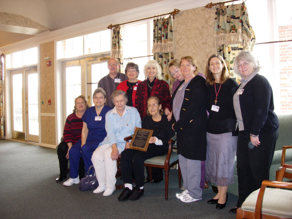 Jean Burrows, surrounded by Deaconess employees, accepts a plaque dedicating the library she founded in her honor.<br/><b>Community Photo By:</b> Leslie Buford<br/><b>Submitted By:</b> Leslie, Oklahoma City