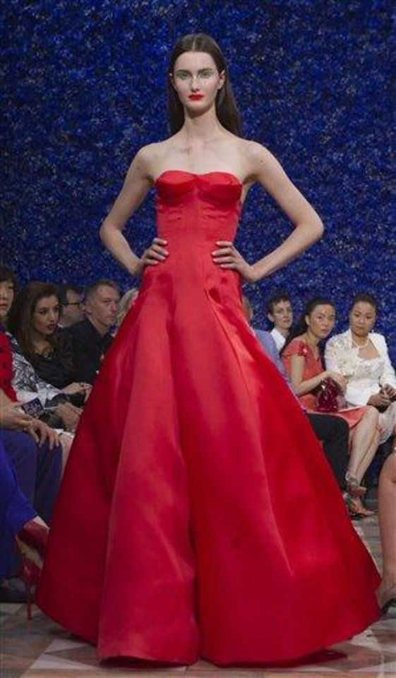 Photo - A model wears a creation by fashion designer Ralf Simons for Dior, during his Women's Fall Winter 2013 haute couture fashion collection, during fashion week in Paris, France, Monday, July 2, 2012. (AP Photo/Jacques Brinon)