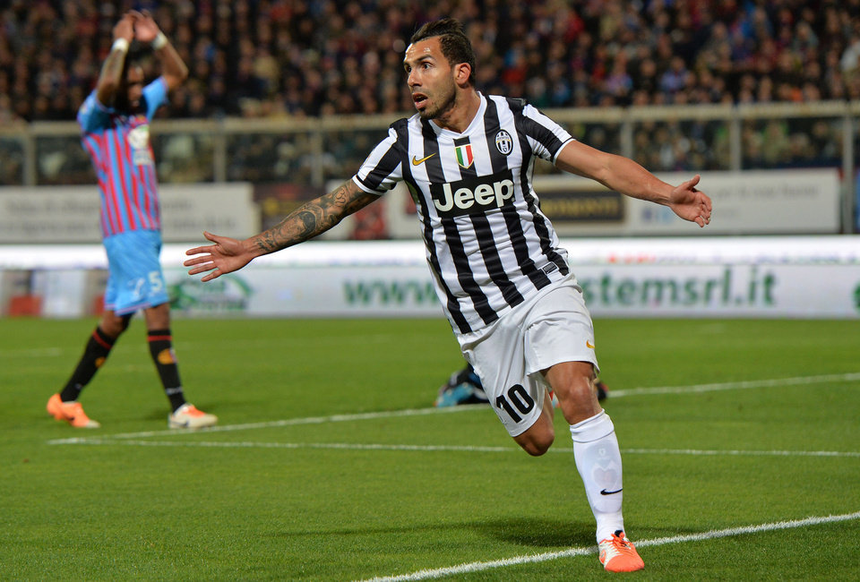 Photo - Juventus forward Carlos Tevez, of Argentina, celebrates after scoring during the Serie A soccer match between Catania and Juventus at the Angelo Massimino stadium in Catania, Italy, Sunday, March 23, 2014. (AP Photo/Carmelo Imbesi)