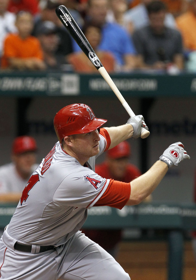 Photo -   Los Angeles Angels' Mark Trumbo hits an RBI double off Tampa Bay Rays starting pitcher Matt Moore during the sixth inning of a baseball game, Thursday, April 26, 2012, in St. Petersburg, Fla. Angels' Torii Hunter scored on the hit. (AP Photo/Chris O'Meara)