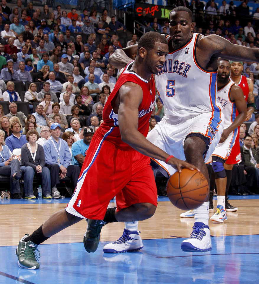 Los Angeles' Chris Paul (3) drives past Oklahoma City's Kendrick Perkins (5) during the NBA basketball game between the Oklahoma City Thunder and the Los Angeles Clippers at Chesapeake Energy Arena in Oklahoma City, Wednesday, April 11, 2012. Oklahoma City lost 100-98. Photo by Bryan Terry, The Oklahoman