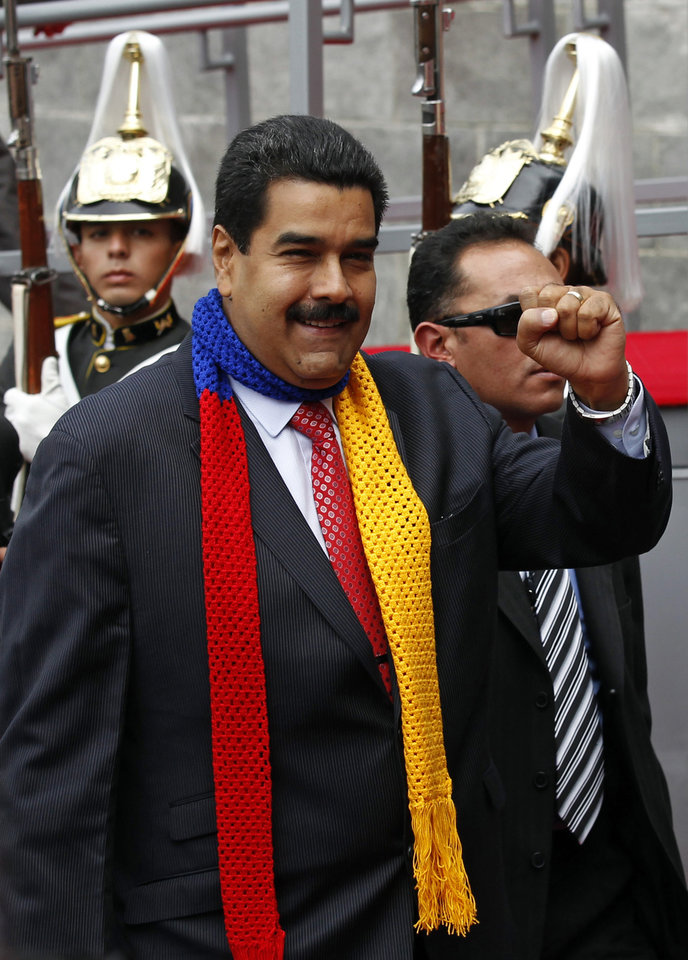 Venezuela's President Nicolas Maduro arrives to attend President Rafael Correa's swearing-in ceremony in Quito, Ecuador, Friday, May 24, 2013. Correa is starting a third term as president. (AP Photo/Dolores Ochoa)