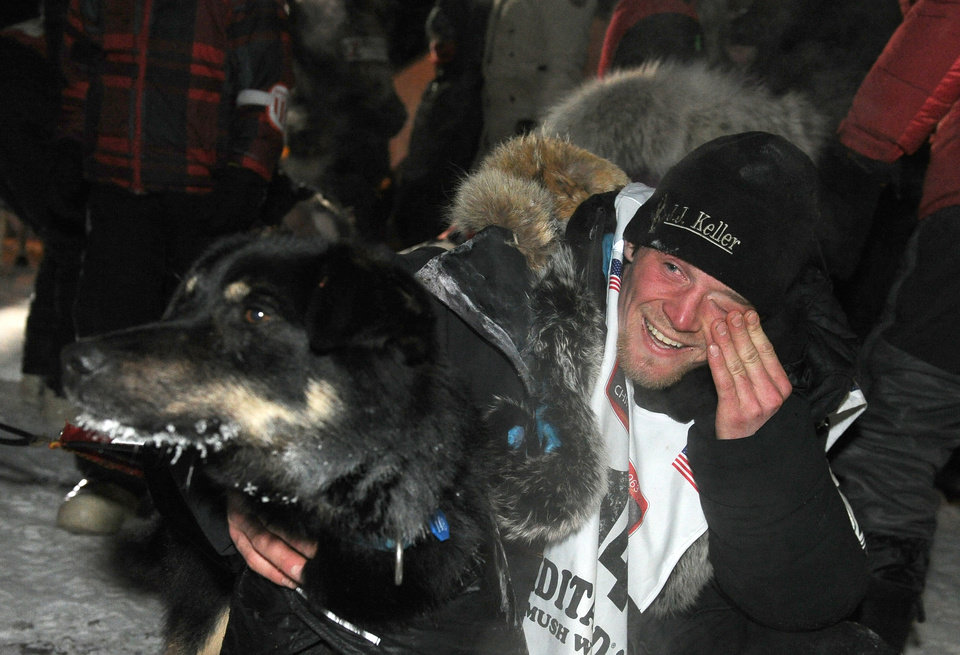 Photo - Dallas Seavey holds one of his dogs after winning the 2014 Iditarod Trail Sled Dog Race in Nome, Alaska, Tuesday, March 11, 2014.  (AP Photo/The Anchorage Daily News, Bob Hallinen)  LOCAL TV OUT (KTUU-TV, KTVA-TV) LOCAL PRINT OUT (THE ANCHORAGE PRESS, THE ALASKA DISPATCH)