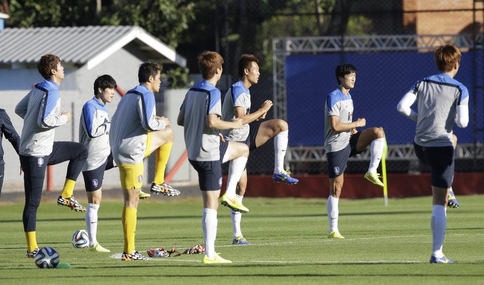 Photo - South Korea's national soccer team players stretch during a training session of South Korea in Foz do Iguacu, Brazil, Thursday, June 19, 2014. South Korea play in group H of the 2014 soccer World Cup. (AP Photo/Lee Jin-man)