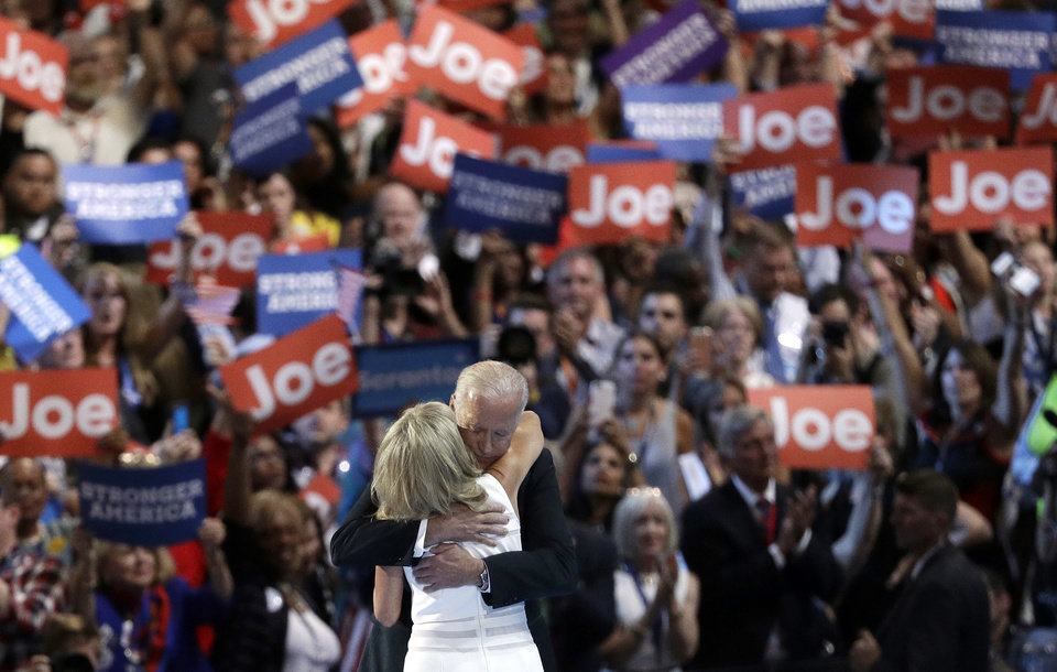 Photo - Vice President Joe Biden hugs his wife Jill Biden on stage during the third day of the Democratic National Convention, Wednesday, July 27, 2016, in Philadelphia. (AP Photo/John Locher)
