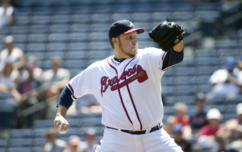 Photo - Atlanta Braves starting pitcher Aaron Harang (34) works against the Los Angeles Dodgers in the first inning of a baseball game Thursday, Aug. 14, 2014, in Atlanta. (AP Photo/John Bazemore)