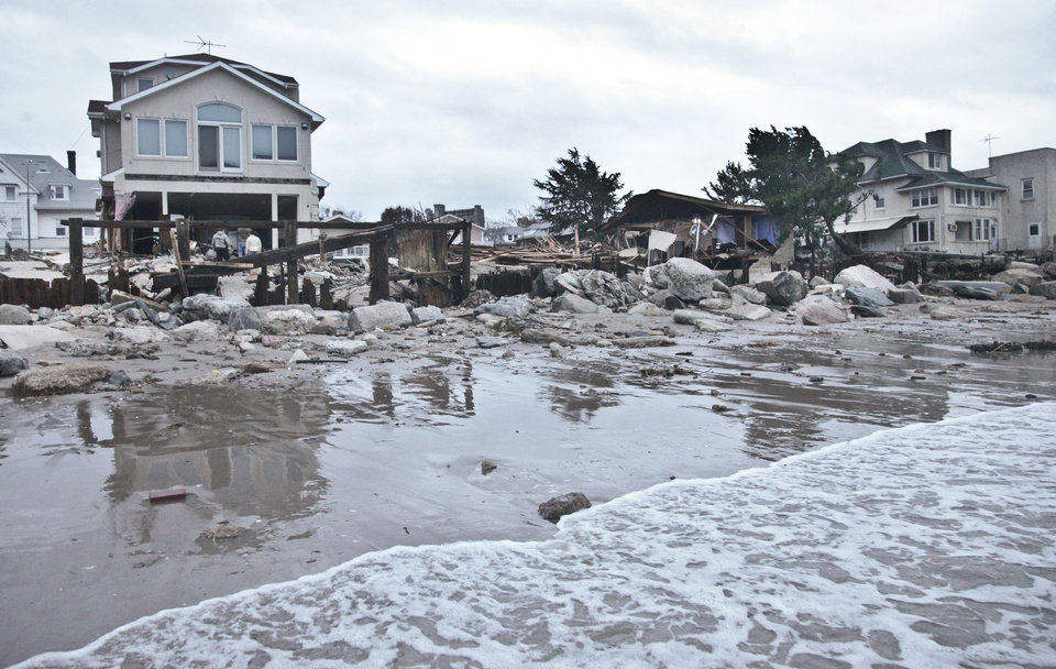 A beachfront house is damaged in the aftermath of yesterday's surge from superstorm Sandy, Tuesday, Oct. 30, 2012, in Coney Island's Sea Gate community in New York. (AP Photo/Bebeto Matthews) ORG XMIT: NYBM121