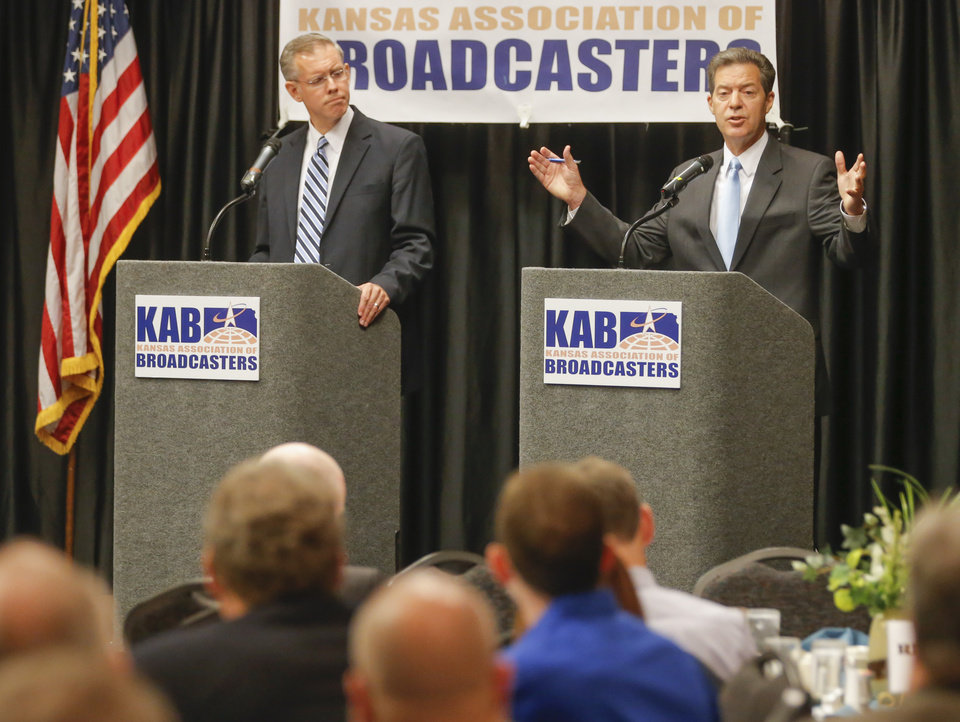 a discussion on the kansas governor race between sam brownback and paul davis Sam brownback describe chaos in the legislature and uncertainty at the polls  two congressional races, they said in a panel discussion thursday at washburn  whoever wins will take on paul davis, who benefits from the.