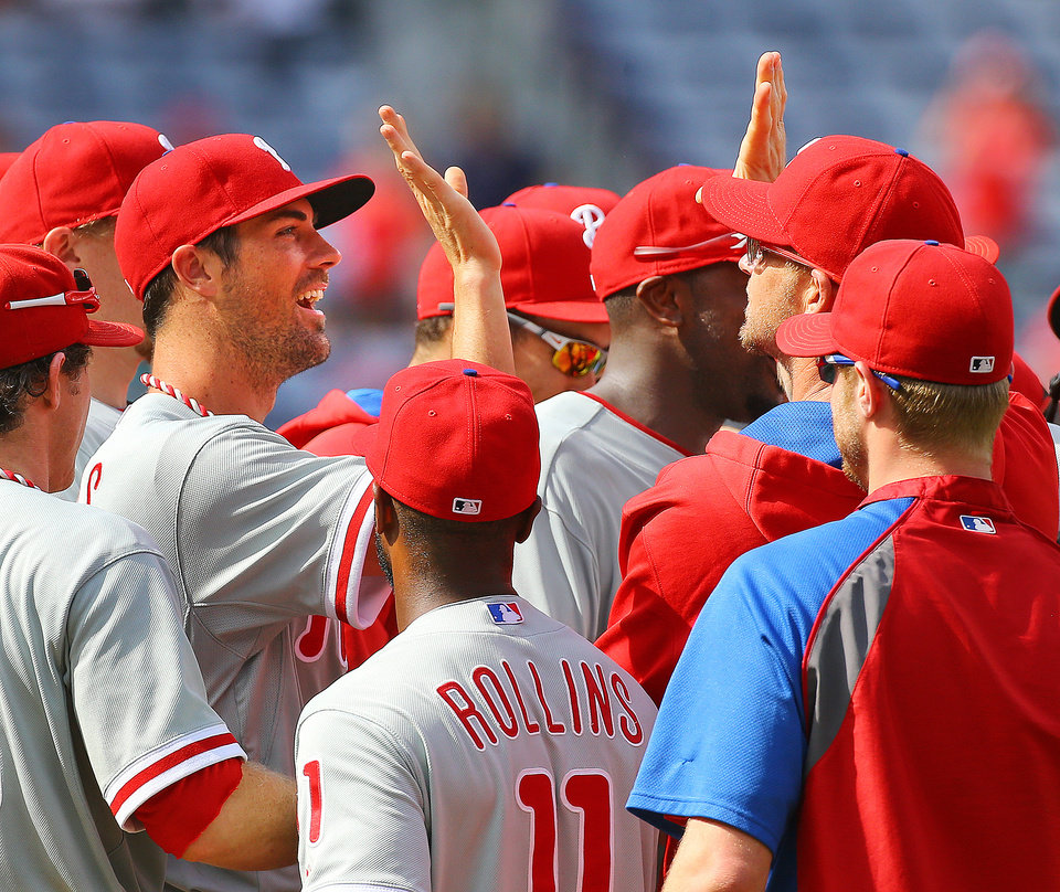 Photo - Philadelphia Phillies Cole Hamels,left, and teammates celebrate a 7-0 no hitter against the Atlanta Braves in a baseball game in Atlanta on Monday, Sept. 1, 2014. Hamels went six innings and relievers Jake Diekman, Ken Giles and closer Jonathan Papelbon combined to no-hit the Braves.  i   (AP Photo/Atlanta Journal-Constitution, Curtis Compton)  MARIETTA DAILY OUT; GWINNETT DAILY POST OUT; LOCAL TELEVISION OUT; WXIA-TV OUT; WGCL-TV OUT