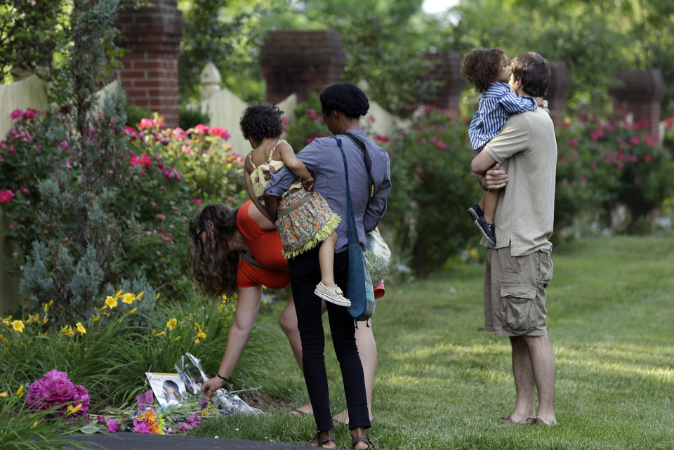 Photo - People visit a memorial outside the home of Maya Angelou in Winston-Salem, N.C., Wednesday, May 28, 2014.  Angelou has died at the age of 86. (AP Photo/Gerry Broome)