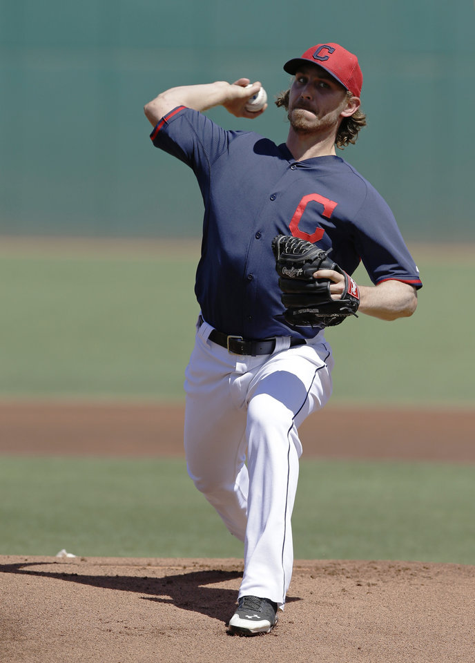 Photo - Cleveland Indians' Josh Tomlin throws before a spring exhibition baseball game against the Texas Rangers Tuesday, March 25, 2014, in Goodyear, Ariz. (AP Photo/Darron Cummings)